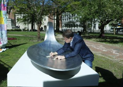 Man signs spoon